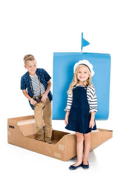 kids with toy ship
