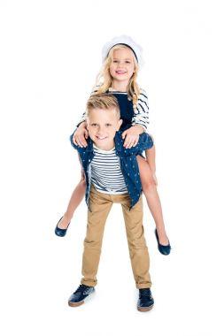 boy piggybacking sister