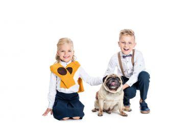 children stroking dog