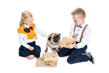 Kids with books and dog