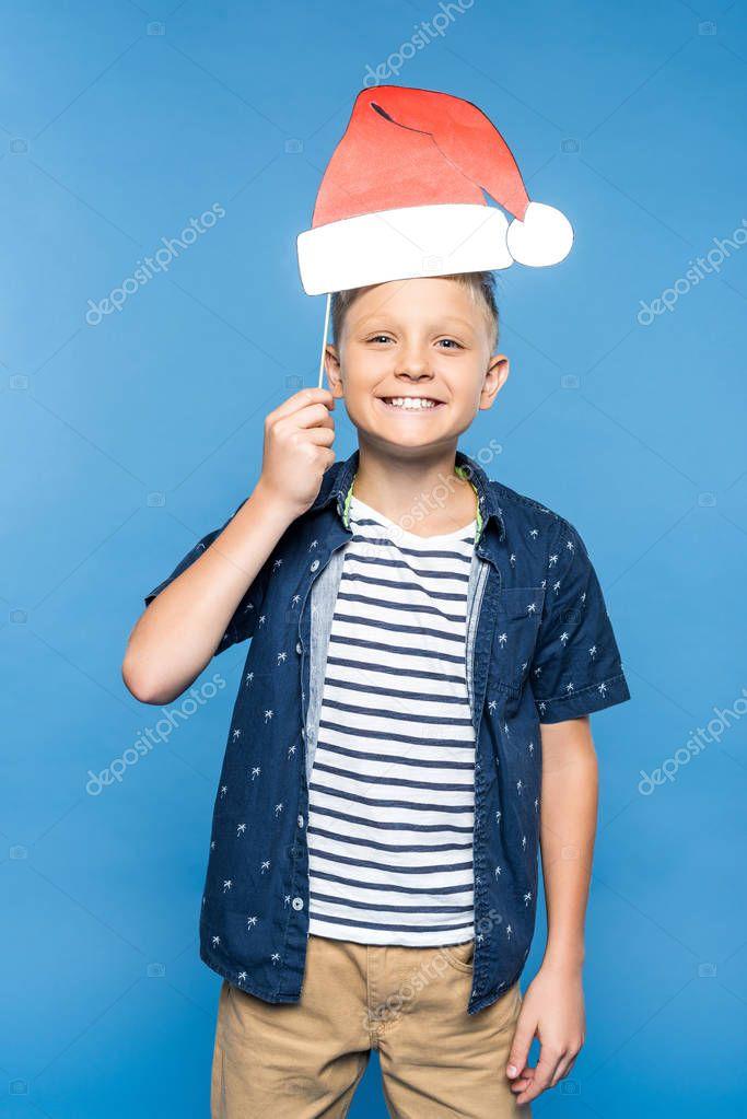 boy with paper santa hat