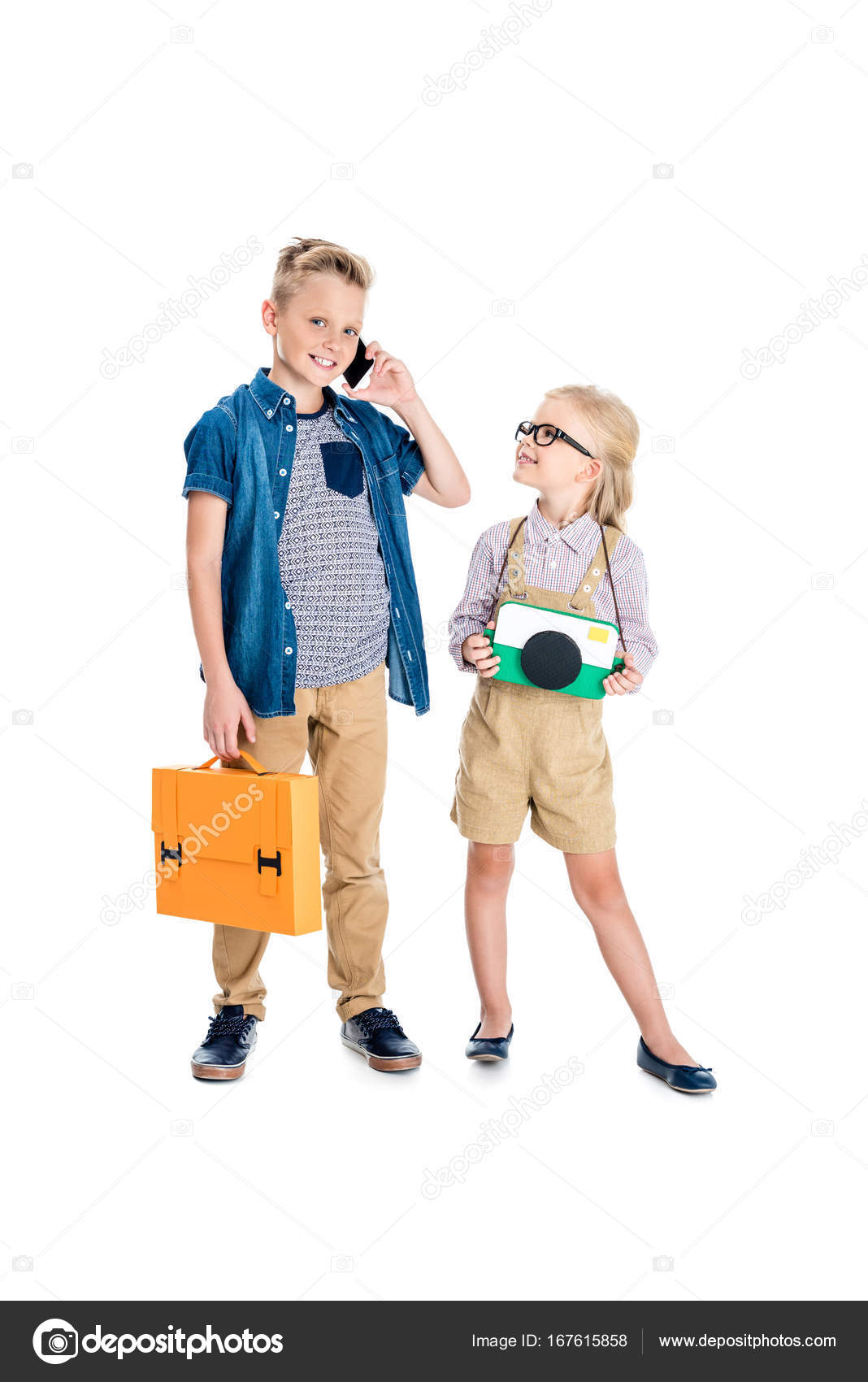 b630c67a6da5 Happy boy holding briefcase and talking on smartphone while smiling little  girl in eyeglasses holding papercraft camera isolated on white — Photo by  ...