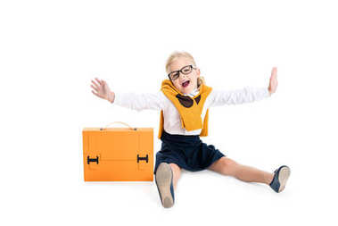 kid in eyeglasses with briefcase