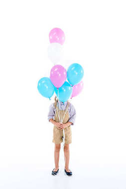 child with colorful balloons