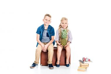 Kids with suitcase and pineapple