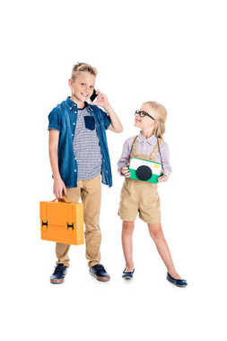 Kids with camera, briefcase and smartphone