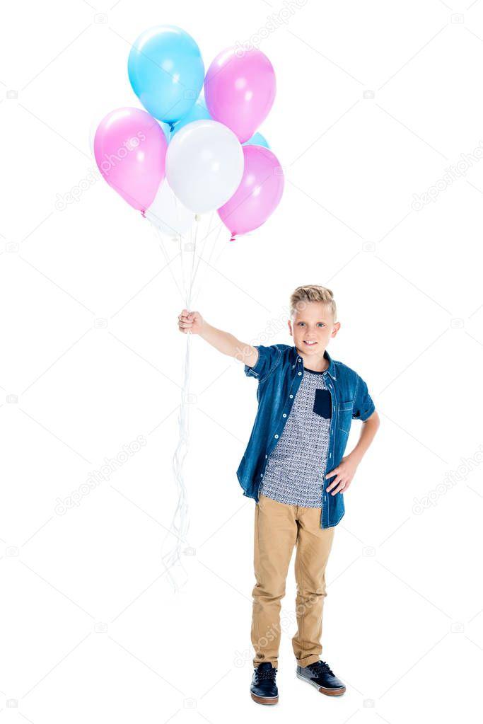 boy holding balloons
