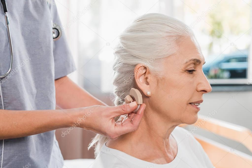 nurse and patient with hearing aid