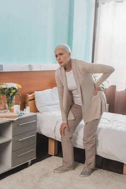 senior woman with backache in hospital