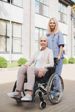nurse and senior woman in wheelchair