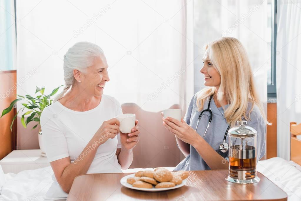 nurse and patient drinking tea