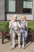 Photo nurse and senior patient with walker