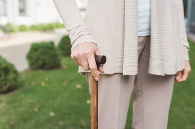 senior woman with cane
