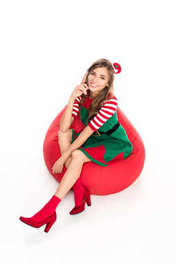 Woman in elf costume on bag chair