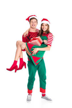 man holding girlfriend with present