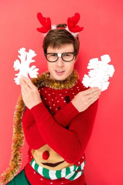 man in sweater with decorative snowflakes