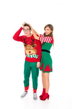 Couple in festive christmas costumes