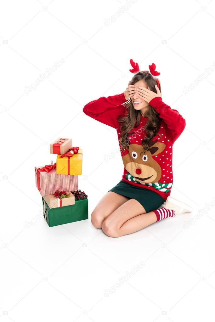 woman in sweater and christmas presents