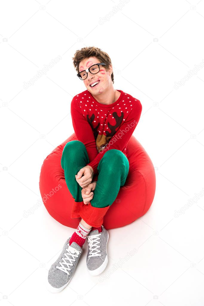 happy man sitting on bag chair