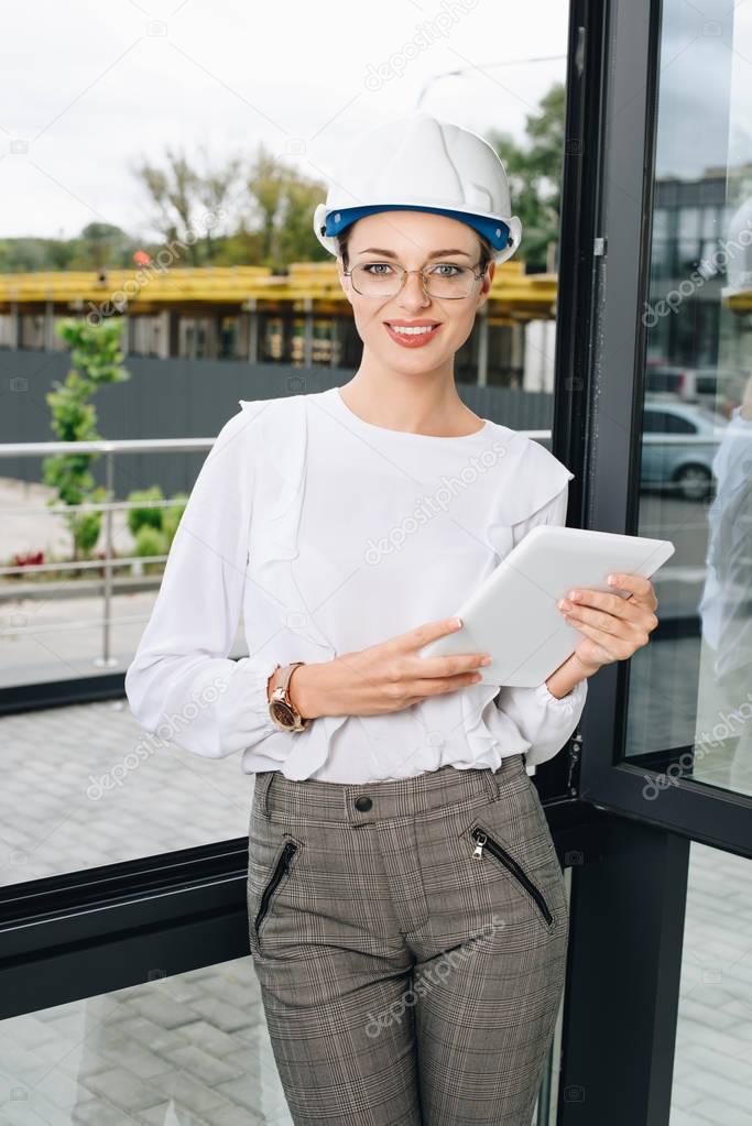 businesswoman at construction site with digital tablet