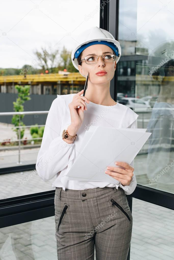 businesswoman at construction site holding paperwork