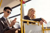 couple riding in city bus