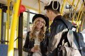stylish couple in public transport