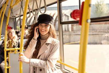 smiling woman talking on smartphone