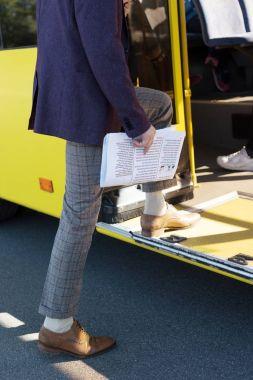 man entering city bus