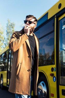 man smoking on street