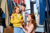 Fotografie mother and children on shopping