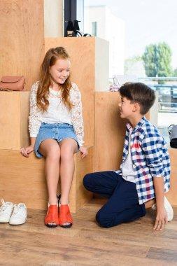 little couple in shoe store