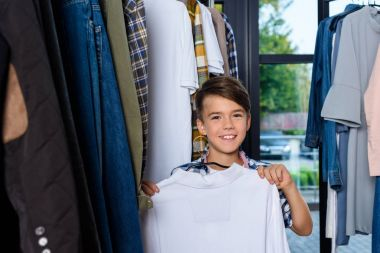 smiling boy in boutique