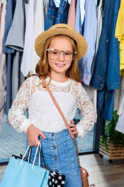 stylish child posing in boutique