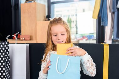 child with shopping bag