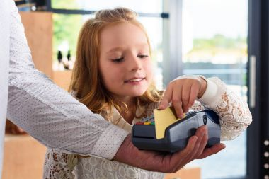 child paying with credit card