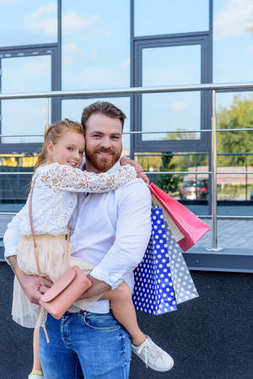 father and daughter with shopping bags
