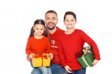 father and children with christmas presents