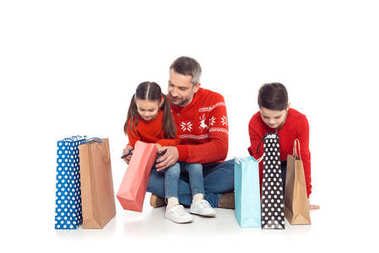 father and kids with shopping bags