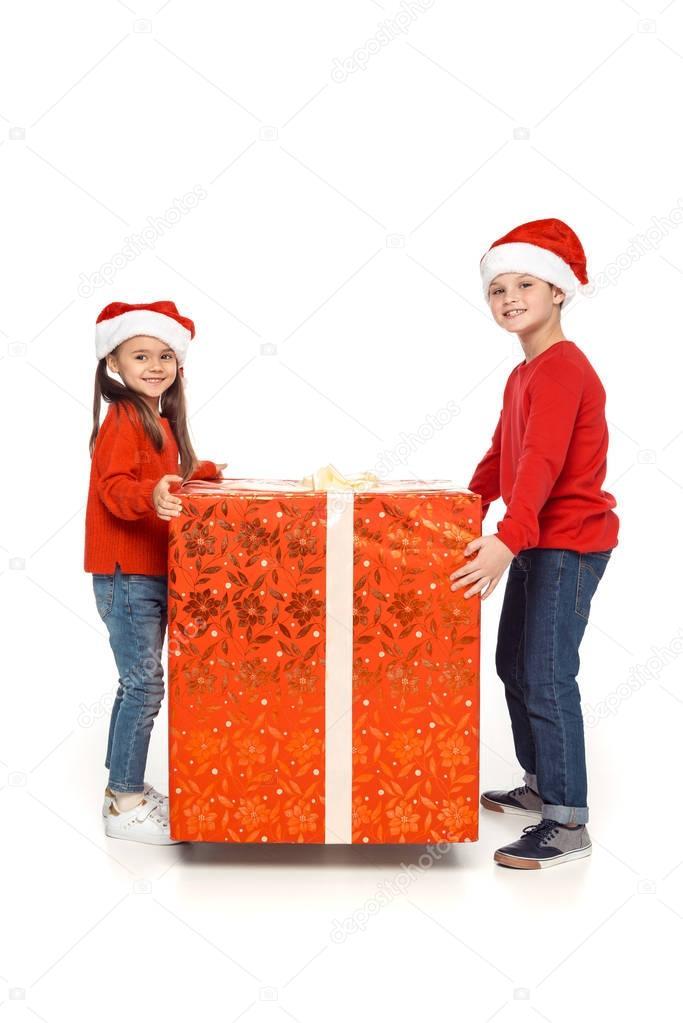 siblings with big christmas present