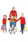 Fotografie family with shopping cart at christmastime