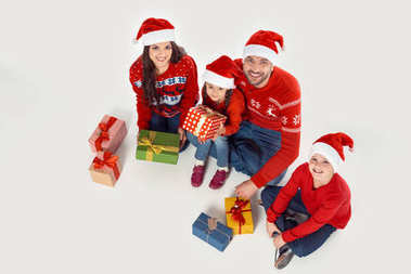 family with christmas gifts