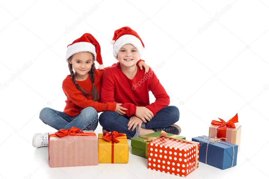 siblings with christmas gifts