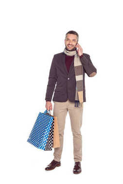 man with shopping bags and smartphone