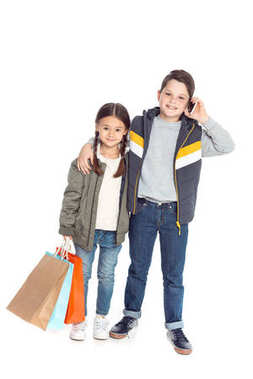kids with shopping bags and smartphone
