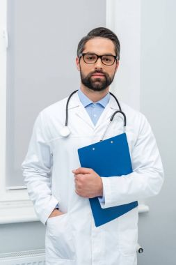 handsome doctor with clipboard