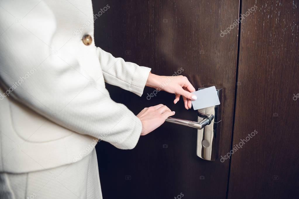 businesswoman opening hotel room door