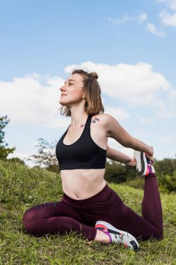 woman in One-legged king pigeon pose