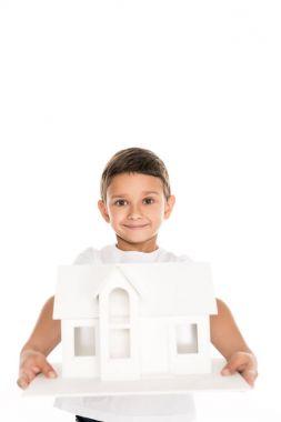 boy holding house model