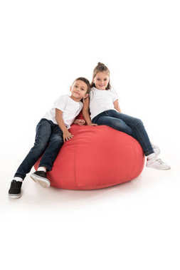 children resting on bag chair